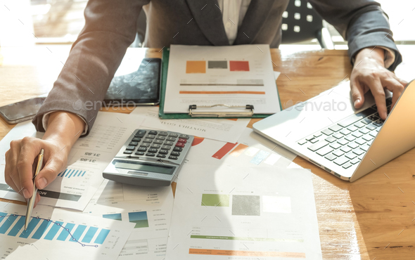 Business concepts,Men wearing suits are using a pen pointing on graph. - Stock Photo - Images