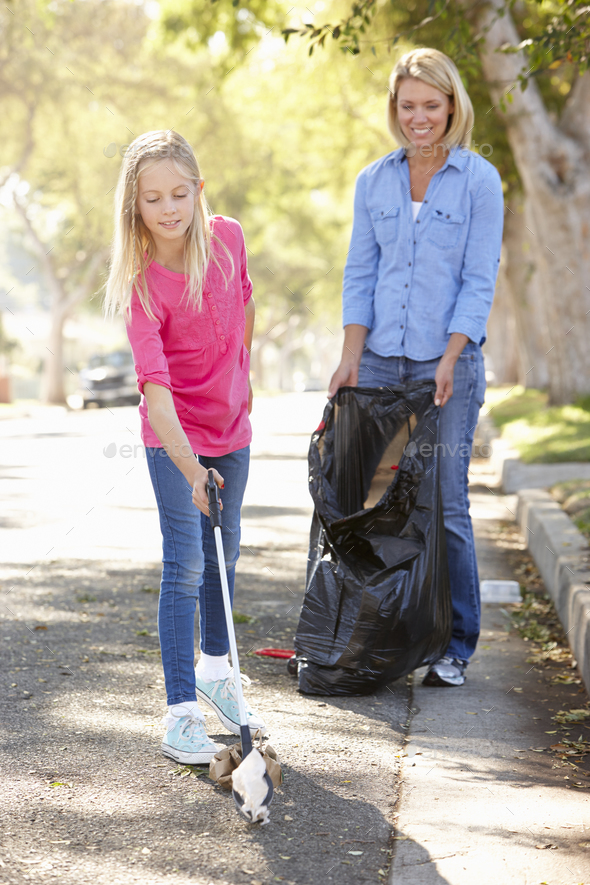 Mother And Daughter Picking Up Litter In Suburban Street - Stock Photo - Images