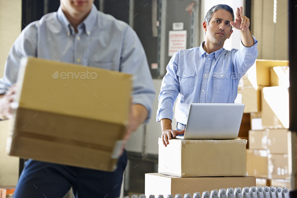 Workers In Distribution Warehouse - Stock Photo - Images