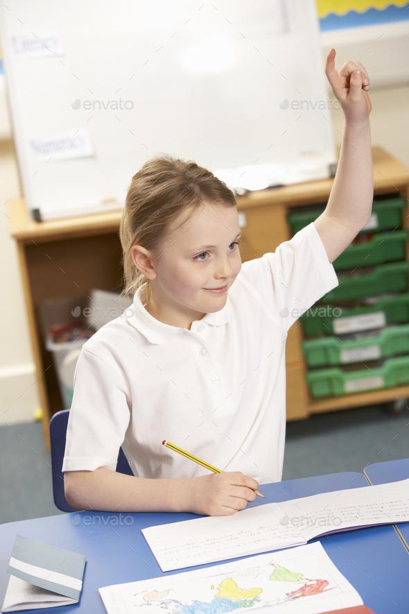 Schoolgirl Studying In Classroom - Stock Photo - Images