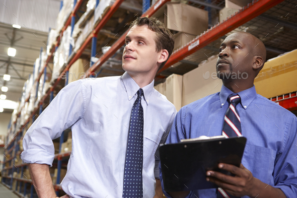 Two Businessmen With Clipboard In Warehouse - Stock Photo - Images