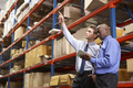 Two Businessmen With Digital Tablet In Warehouse - PhotoDune Item for Sale