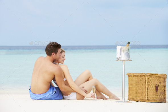 Couple On Beach With Luxury Champagne Picnic - Stock Photo - Images
