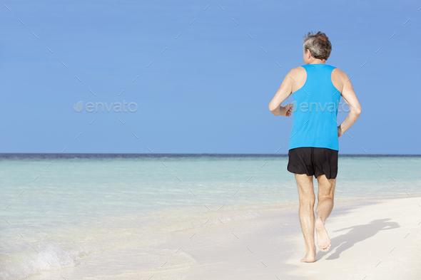 Senior Man Running On Beautiful Beach - Stock Photo - Images