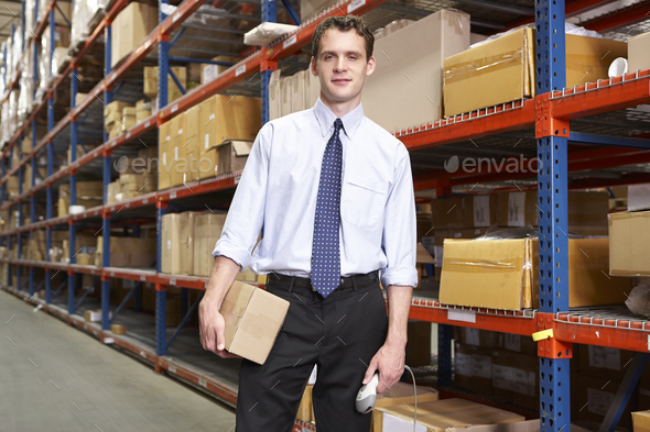 Businessman With Package And Scanner In Warehouse - Stock Photo - Images