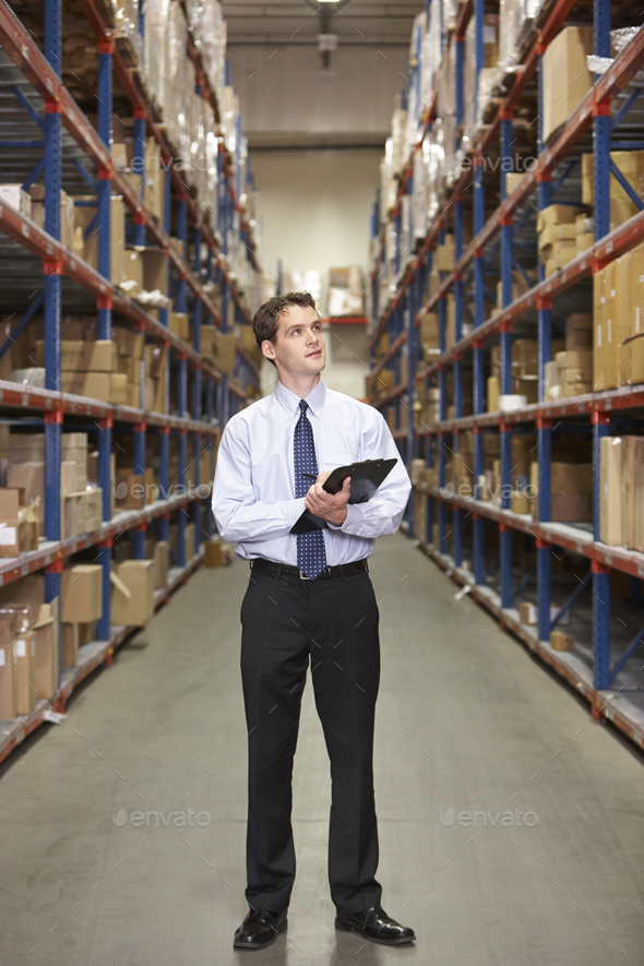 Manager In Warehouse With Clipboard - Stock Photo - Images