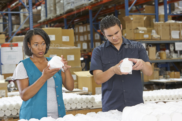 Factory Workers Checking Goods On Production Line - Stock Photo - Images