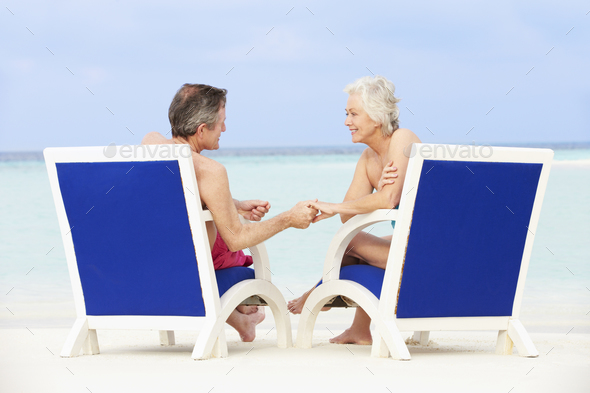 Senior Couple On Beach Relaxing In Chairs - Stock Photo - Images