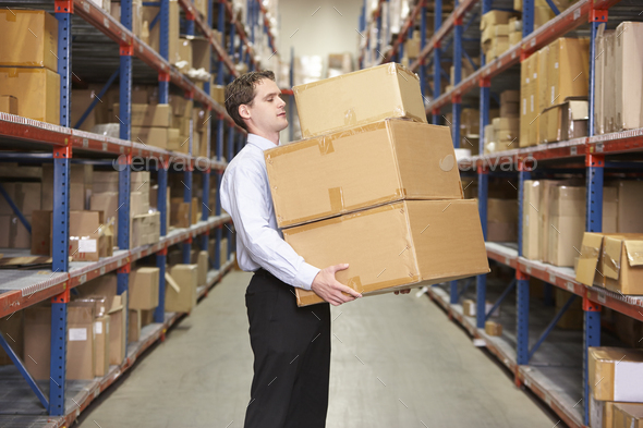 Man Carrying Boxes In Warehouse - Stock Photo - Images
