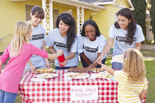 Women And Children Running Charity Bake Sale - Stock Photo - Images