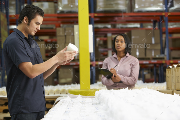 Factory Worker And Manager Checking Goods On Production Line - Stock Photo - Images