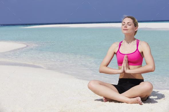 Woman Meditating On Beautiful Beach - Stock Photo - Images