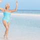 Senior Woman Splashing In Beautiful Tropical Sea - PhotoDune Item for Sale