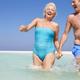 Senior Couple Having Fun In Sea On Beach Holiday - PhotoDune Item for Sale