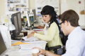 Woman Working At Desk In Busy Creative Office - PhotoDune Item for Sale