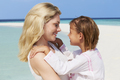 Mother And Daughter Hugging On Beautiful Beach - PhotoDune Item for Sale