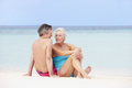 Senior Couple Relaxing On Beautiful Beach Together - PhotoDune Item for Sale
