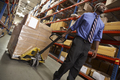 Man Pulling Pallet In Warehouse - PhotoDune Item for Sale