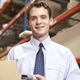 Businessman Scanning Package In Warehouse - PhotoDune Item for Sale