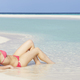 Woman Lying On Beach Wearing Santa Hat - PhotoDune Item for Sale