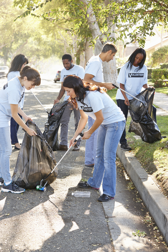 Team Of Volunteers Picking Up Litter In Suburban Street - Stock Photo - Images