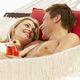 Romantic Couple Relaxing In Beach Hammock - PhotoDune Item for Sale