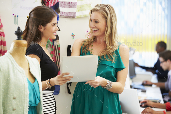 Two Women Meeting In Fashion Design Studio - Stock Photo - Images