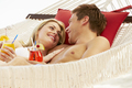 Romantic Couple Relaxing In Beach Hammock - PhotoDune Item for Sale