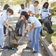 Team Of Volunteers Picking Up Litter In Suburban Street - PhotoDune Item for Sale