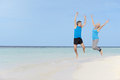 Senior Couple Jumping On Beautiful Beach - PhotoDune Item for Sale