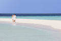 Romantic Couple Walking On Beautiful Tropical Beach - PhotoDune Item for Sale