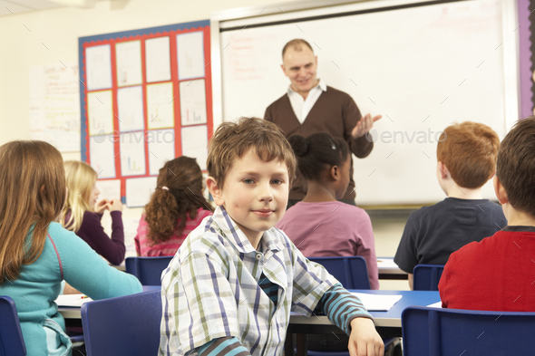 Schoolchildren Studying In Classroom With Teacher - Stock Photo - Images
