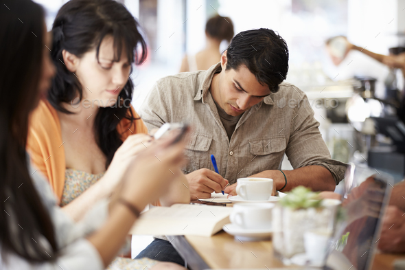 Customers In Busy Coffee Shop - Stock Photo - Images