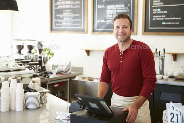Customer Paying In Coffee Shop Using Touchscreen - Stock Photo - Images