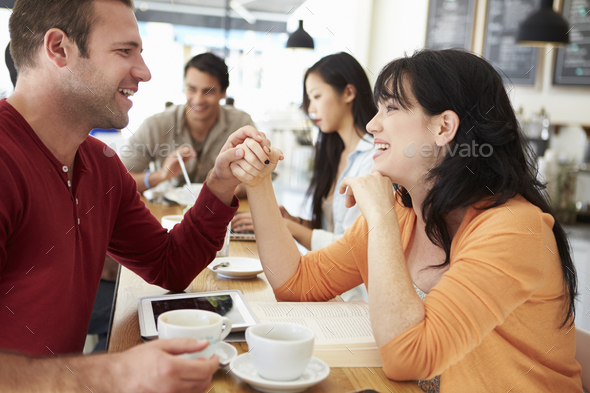 Romantic Couple Meeting In Busy Café - Stock Photo - Images