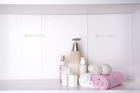 Composition with spa cosmetic, candles and brush for face, isolated on white - Stock Photo - Images