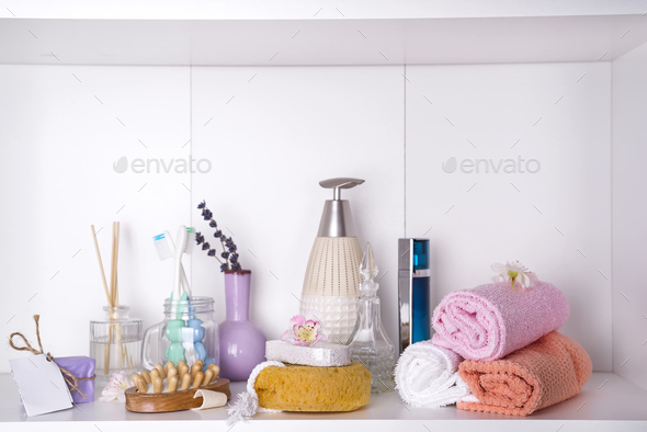 Various spa and beauty threatment products on white shelf - Stock Photo - Images
