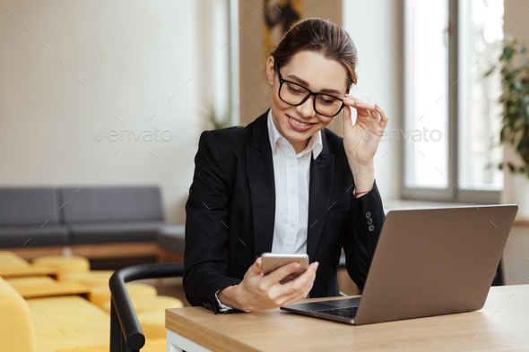Young happy business lady work - Stock Photo - Images