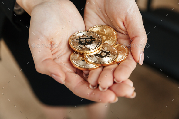 Business lady showing her bitcoins in hands. - Stock Photo - Images
