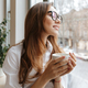 Cute business woman sitting in cafe drinking coffee - PhotoDune Item for Sale