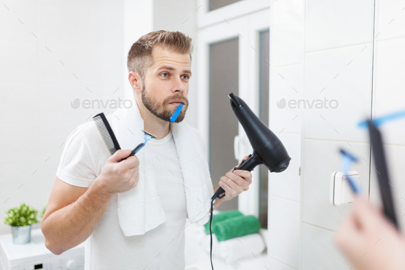 Morning hygiene, Man in the bathroom and his morning routine - Stock Photo - Images