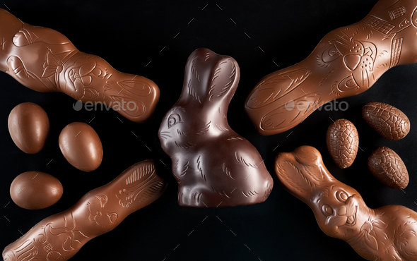 Chocolate Easter bunny and eggs on dark background - Stock Photo - Images