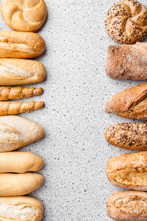 Variety of delicious fresh bread and baguettes - Stock Photo - Images