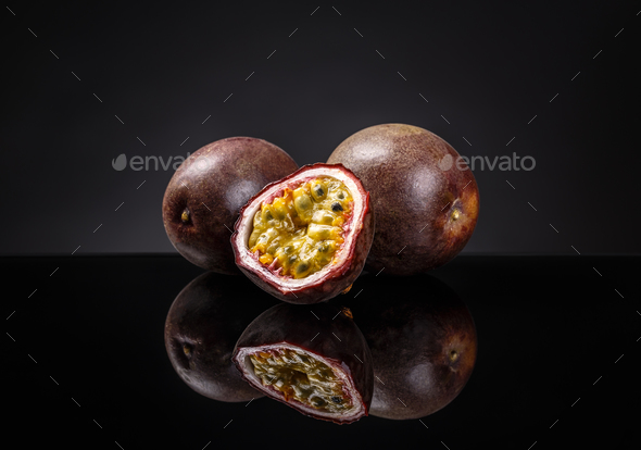 Whole and half passion fruits - Stock Photo - Images