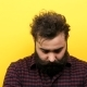 Bearded Hipster Rising His Head up and Smiling to the Camera on Yellow Background - VideoHive Item for Sale