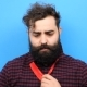 Bearded Man Tries to Tie a Tie and Can Not Do It - VideoHive Item for Sale
