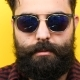 Natural Smiling Long Bearded Hipster with His Sunglasses on - VideoHive Item for Sale