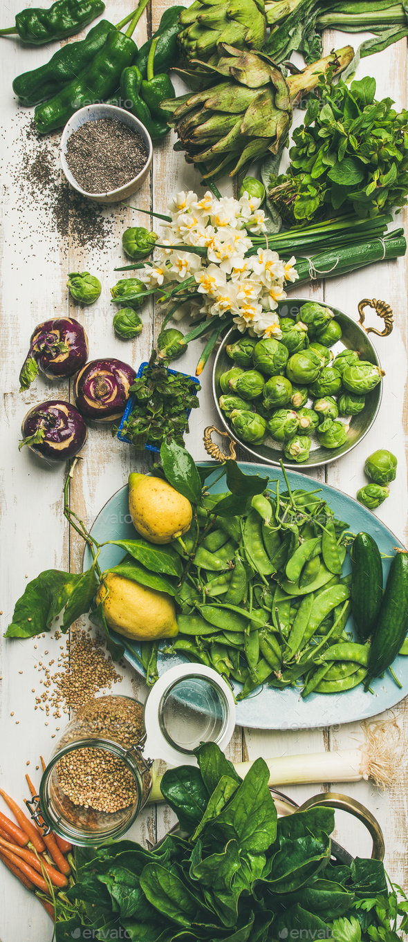 Spring healthy vegan food cooking ingredients, top view, vertical composition - Stock Photo - Images