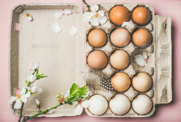 Natural colored eggs in box for Easter - Stock Photo - Images