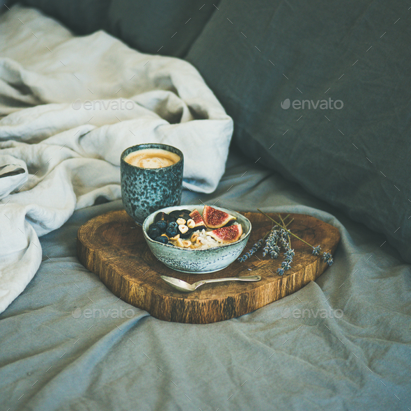 Rice coconut porridge and espresso in bed, square crop - Stock Photo - Images